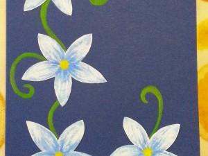Biglietto blu con fiori azzurri